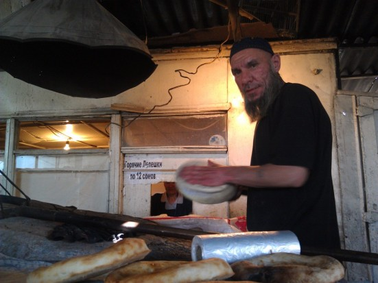 We bought bread from this guy, the traditional Central Asian bread is kneaded flat, and then slapped against the wall of a clay oven to bake it.