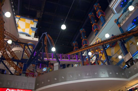 A roller coaster INSIDE of the shopping mall, over the top perhaps?!